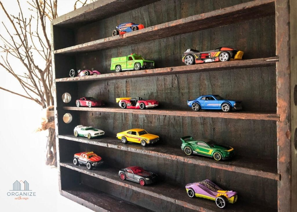 antique wooden shelf with toddler cars