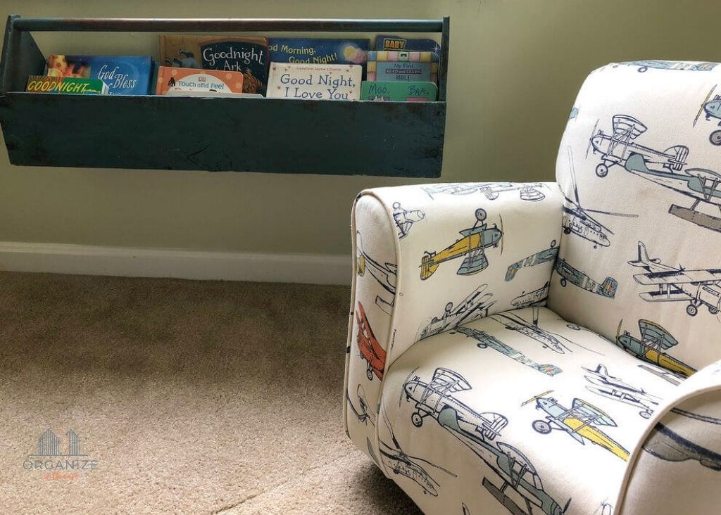toddler chair with airplane print and bookshelf
