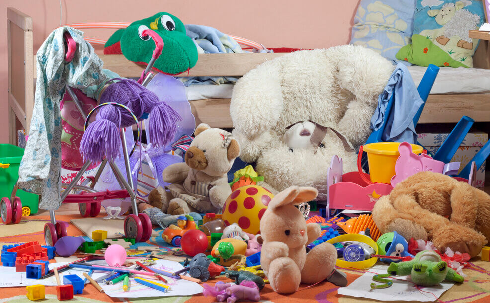 messy room with bright kids toys