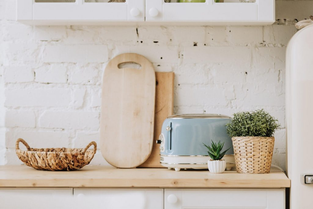 vintage ktichen with cutting boards and blue toaster