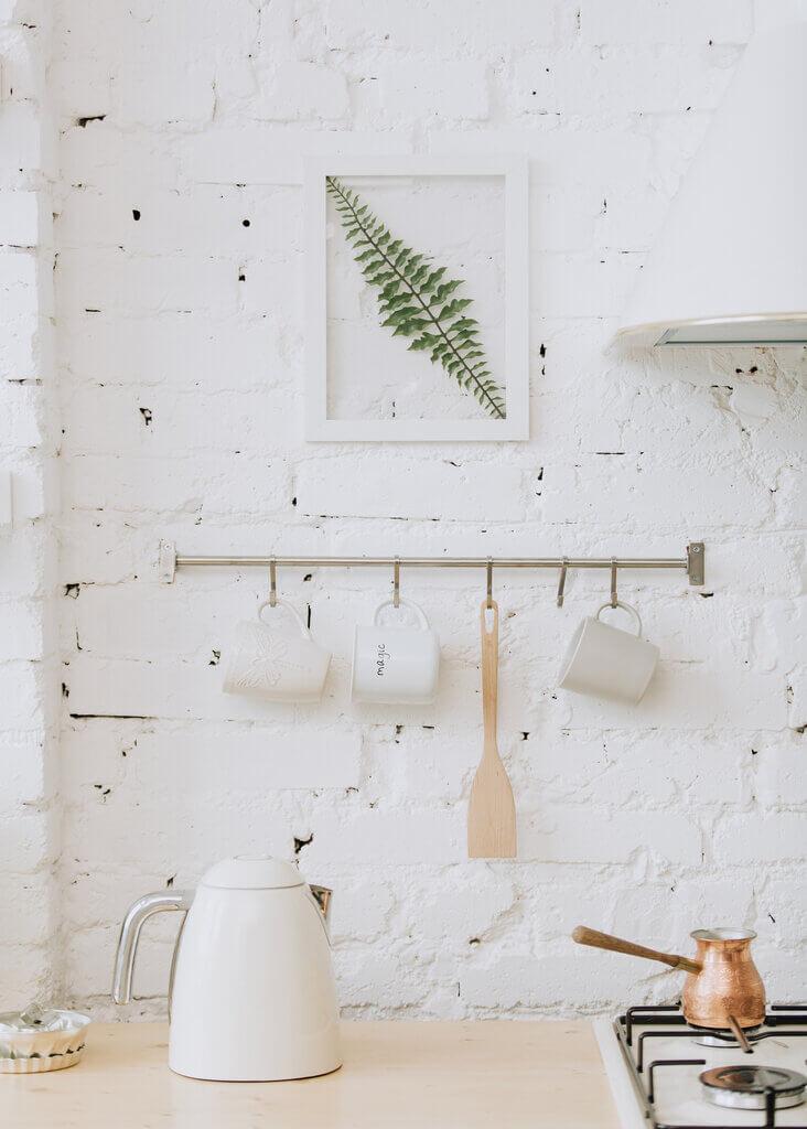 white brick kitchen with copper pot