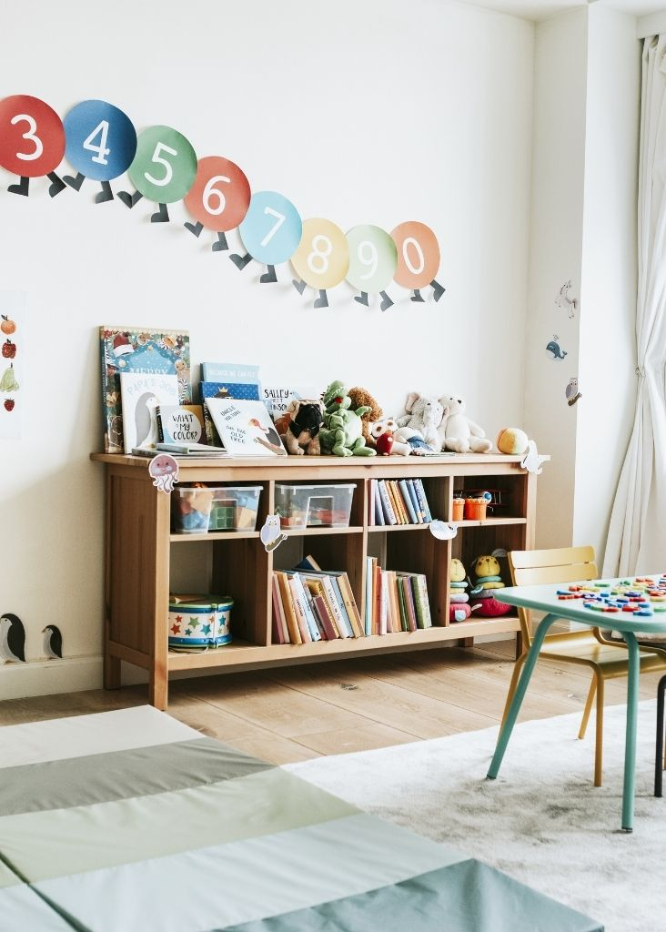 bookcase of toys and books for toy rotation
