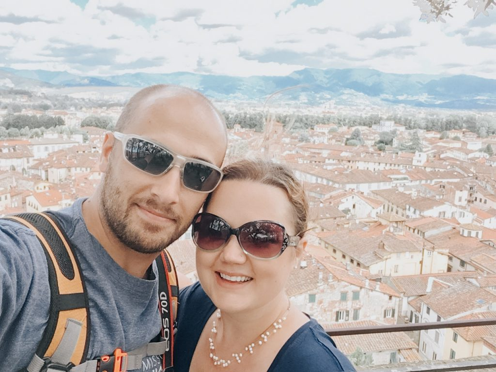 husband and wife in bell tower in Italy