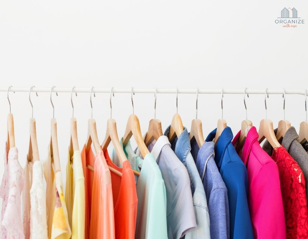 decluttered rainbow clothing in closet